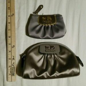 Two Coach silver miscellaneous  pouches